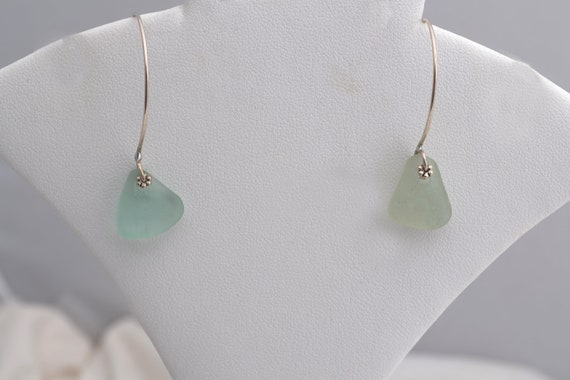 Sea Glass Jewelry  here.  Pale aqua sea glass on long silver wire     EARRINGS.              FREE SHIPPPING