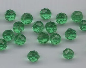 24 extremely rare vintage Czech crystals - round faceted with asymmetric holes - light emerald - 9 mm