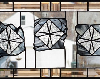 Modern geometric stained glass panel with beveled glass
