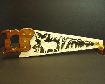 Scenic wooden hand saw.