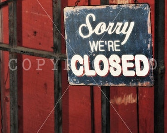 black and red 'sorry we're closed' print