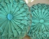 Two vintage green circle pillows