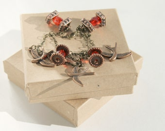 Ruby and Bronze Chain Bracelet with Bronze Birds and Ruby Red Bead Dangles