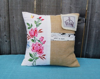 Vintage embroidered pillow with a crown