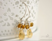 Earrings wire wrapped with yellow citrine glass crystal and glass beads with round silver ear wire.