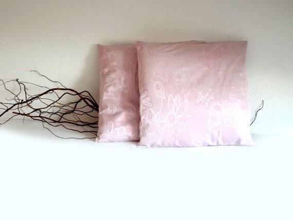 Pink pillow covers, in a black taffeta basket, charming ornament for girl's room