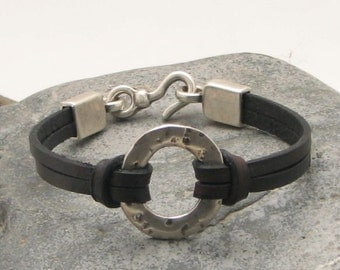 EXPRESS SHIPPING Women's leather  bracelet. Black thin flat multi strap leather bracelet with silver plated  textured donut ring and clasp.