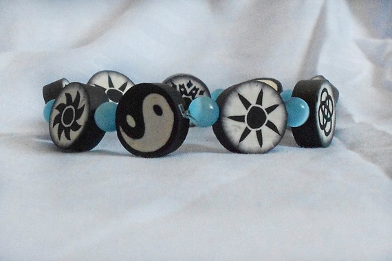 Zen Funk Bracelet - Clay black and white beads with Cat's Eye Glass blue