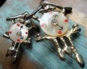 Pair of Coo Coo Clock Pins