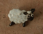 Black and white sheep,  ceramic magnet