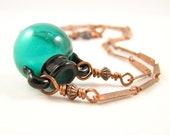 Teal glass vessel and copper vintage necklace