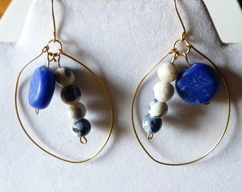 hand made glass bead matched with blue sodalite beads on a hand made red brass hoop earrings