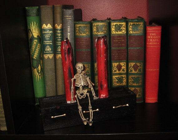 Candles with casket holder and skeleton