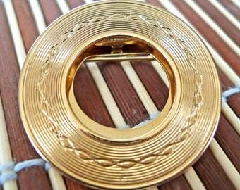 Gold textured circular brooch