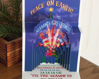 Pop up Christmas Carolers card with singing carolers