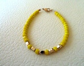 Freindship bracelet - yellow crystals- pink gold beads