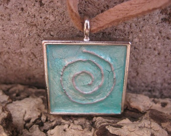 Silver 3D Spiral with an Aqua Background in a Silver Square Pendant