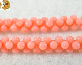 15 inch strand of Pink Bamboo Coral smooth bone beads 4x8 mm
