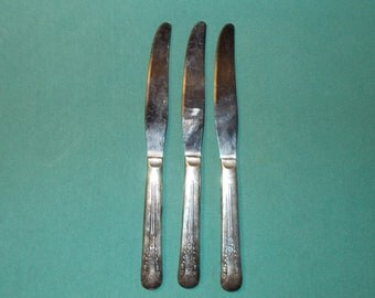 """Three (3), 8 5/8"""" Solid Handled, Silver Plated,  Dinner Knives, from Camelia / International silver, in the Camelia 1940 Pattern."""