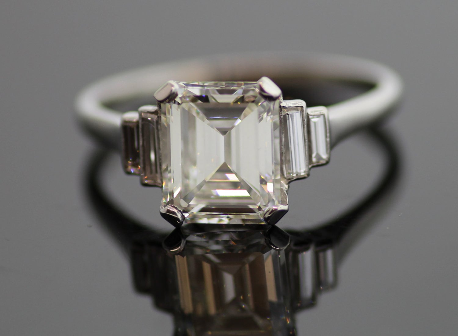 Vintage Platinum Emerald Cut Diamond Engagement Ring With