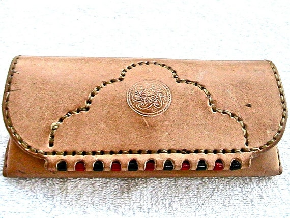 Natural leather eyeglass case with suede lining and red and black pony bead inlay.