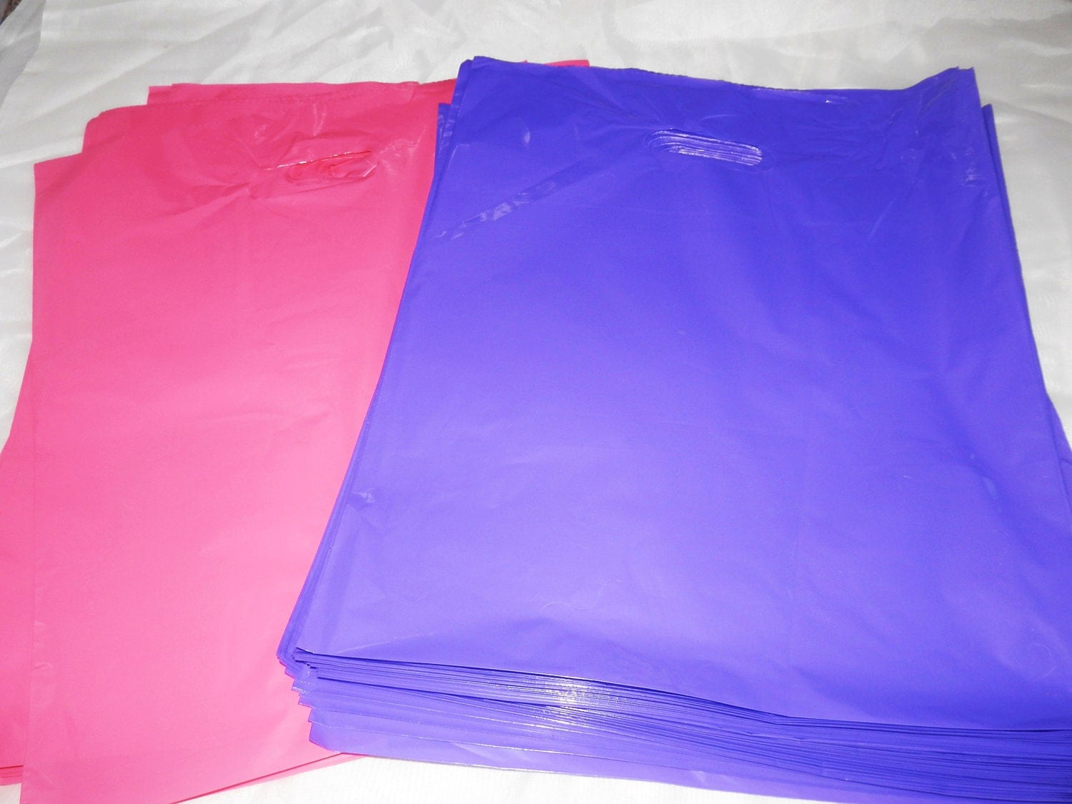 100 12x15 glossy pink and purple plastic merchandise bags for 12x15 calculator