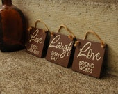 live every moment, laugh every day, love beyond words, wood sign