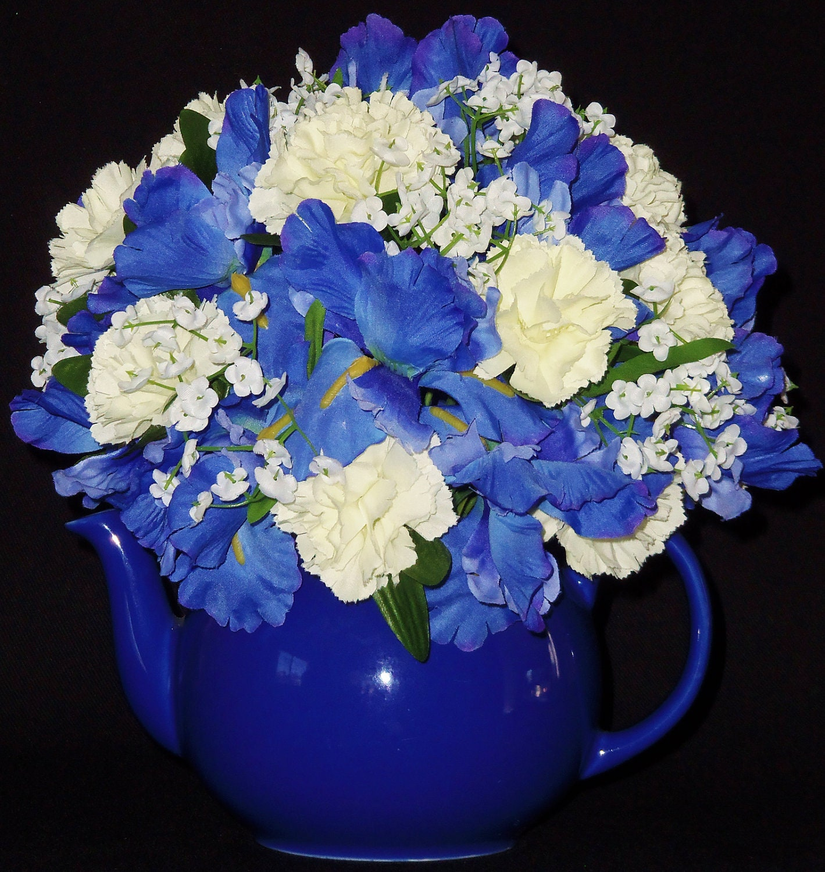 Silk flower arrangement blue iris white carnations