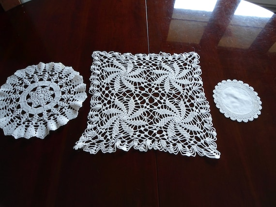 Set of three misc. white hand corcheted  doilies