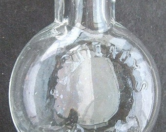 Tiny antique bottle R. E. STIEAUX'S PILLS glass pill flask for pocket or purse 1800's.