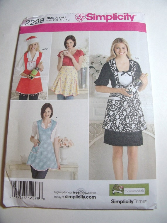 New Simplicity Pattern womens Apron sizes small medium large Four styles with extras uncut