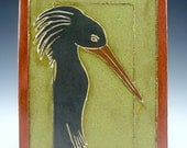 Handmade ceramic tile of Asian inspired Black Crane,  green background with rusty red border
