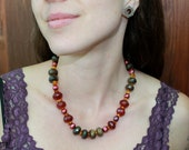 Raw faceted Ruby, faceted Tigers Eye, Amber, and Pearl Necklace