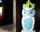 Ceramic Owl Sculpture in Teal Green White and Red featuring a Large Green Bouquet