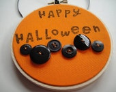 Happy Halloween 4 inch orange and black stamped Halloween hoop decor