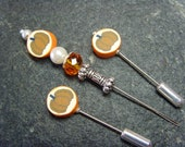 Halloween Embroidery tools. A thread catcher in a set with two matching needlework counting pins. Pumpkin pie