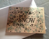 "Christmas Card, ""Let it snow"", tan, black, and blue snowflakes"