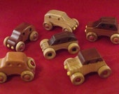 TOY CAR WOODEN this price is for one .