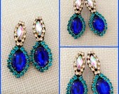 Amira earrings - made of sapphire resin cabochons, aurora borealis and blue zircon crystals, surgical steel posts on grey felt foudation