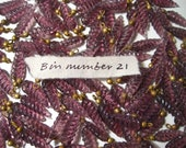 Purple leaf cast glass beads with brass loop, 4 ounces, 105 beads, bin number 21