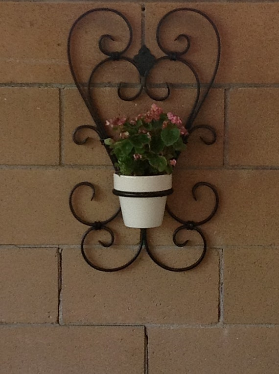 Wrought Iron Wall Sconces Flowers : Items similar to Two heart wrought iron flower pot holder on Etsy