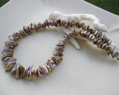"""12"""" Pondslime centre-drilled cupped keshi pearls"""