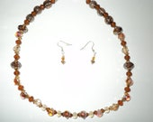 Brown, Bronze and gold Unicorne Lampwotk Beaded Necklace