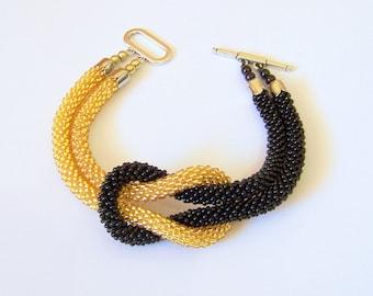 Beadwork - Bead Crochet Bracelet in black and gold - Beaded Bracelet - Infinity Knot Bracelet - Beaded Bracelet Cuff