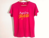80s vintage medium size aged to perfection tshirt soft and thin, few small spots