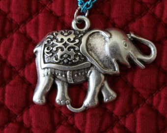 Circus Elephant with a matte finish , Pewter color pendant on a blue aluminum chain, Decorative blanket on his back, Birthday gift