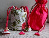 A pair of Pull string bag -1 Quilted draw string bag in pink, 2) Floral print quilted draw string bag in pink.