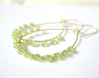 Peridot earrings. Green teardrop hoop earrings.