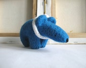 Blue bear with a white knitted scarf