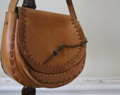 Vintage leather tooled handbag with funky pin fastening